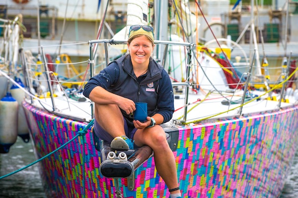 Lisa Blair on bow of her boat Dean Coopman pic